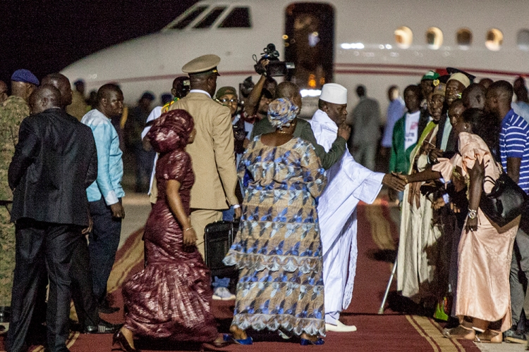 Deposed dictator, Yahya Jammeh, shakes hands with well-wishers at Banjul International Airport as he prepares to head to exile in Equatorial Guinea. Image ©Jason Florio