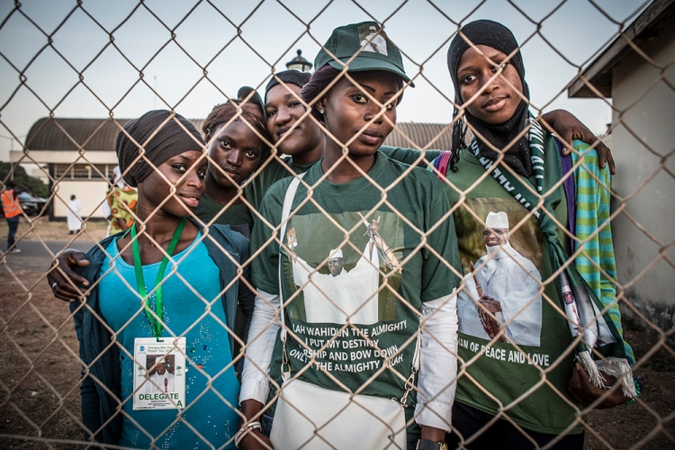 Supporters of the ex-president Yahya Jammeh of The Gambia wait at Banjul airport to say goodbye him as he leaves Gambia for exile in Guinee. He lost the election to Adama Barrow on December 2nd 2016 but refused to step down until today. Image ©Jason Florio