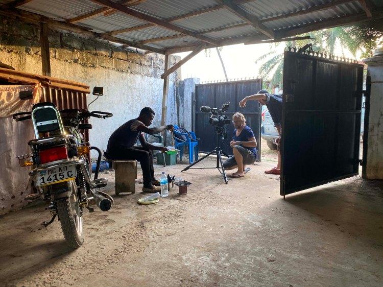 Photographer & filmmaker - Jason Florio on location filming, The Gambia, West Africa. Image ©Helen Jones-Florio