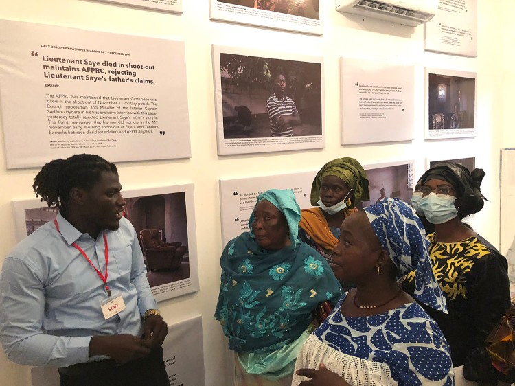 Opening of 'Memory House', The Gambia, West Africa. A guide shows a group of Gambian women around the exhibition. Images ©Jason Florio & Helen Jones-Florio from 'Gambia - victims, and resisters'