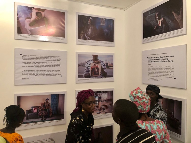 Opening of 'Memory House', The Gambia, West Africa. A group of Gambian women looking at the exhibition. Images ©Jason Florio & Helen Jones-Florio from 'Gambia - victims, and resisters'