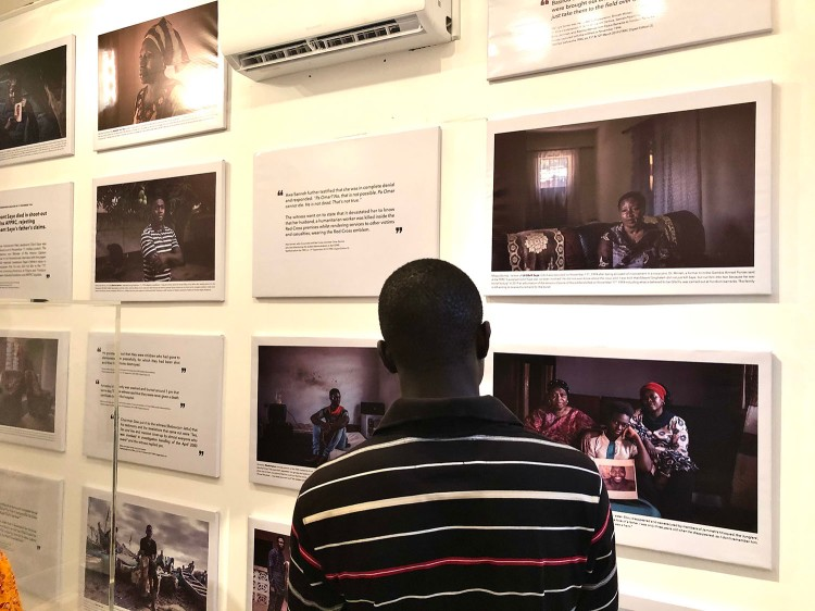 Opening of 'Memory House', The Gambia, West Africa. A young Gambian man looking at the exhibition. Images ©Jason Florio & Helen Jones-Florio from 'Gambia - victims, and resisters'